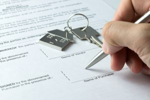 Signing-Real-Estate-Document-with-Keys-to-Property