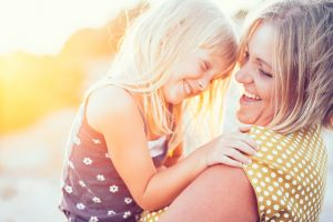 Mother and Daughter Smiling in Sunset