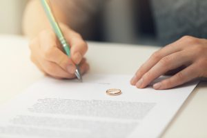 Woman Signing Papers for Divorce